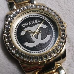 Gold tone watch homage to Chanel